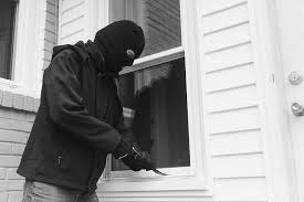 image of a burglar entering a home